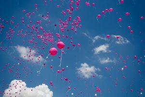 pink balloon lot on air during daytime